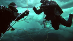 Divers emerge from the depths of the Arctic Ocean at the North Pole. Stock Footage