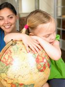 Mother and daughter exploring the world - stock photo