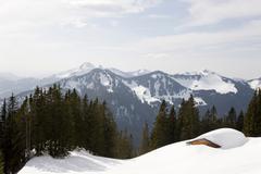 Snow covered mountains, alpine hut Stock Photos