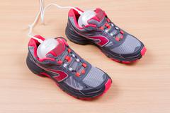 Electric ultraviolet shoe dryer and Sneakers. - stock photo