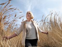 Mature woman walking in reeds Stock Photos