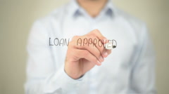 Loan Approved,  Man writing on transparent screen - stock footage