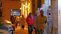 People tourists walking shopping at night street in Rome Italy Stock Footage