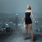 Futuristic woman in night city Kuvituskuvat