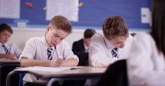 4K School children working at their desks in classroom Arkistovideo