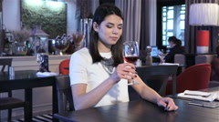 Girl waits for somebody at the restaurant Stock Footage