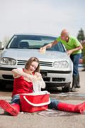 old man and young girl washing car - stock photo