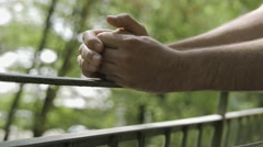 4K Anxious Hands of A Man Standing On a Balcony Stock Footage