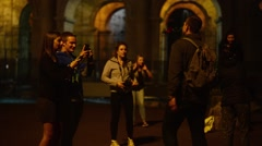 Coliseum at Night. Young friends have fun making photo selfie - stock footage