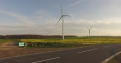 Wind Turbine in rapeseed fields Stock Footage