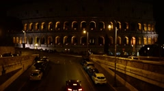 Rome Italy night traffic lights near Colosseo, Coliseum - stock footage