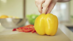 Yellow pepper at the kitchen table Stock Footage