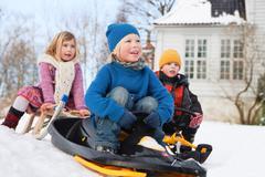 Scandinavian children on sleds - stock photo