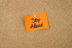 Step Ahead written on orange paper note - stock photo