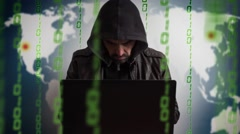 Hacker in a hood with laptop. Online world network danger Stock Footage