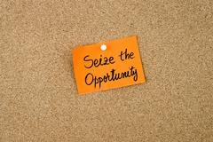 Seize The Opportunity written on orange paper note - stock photo