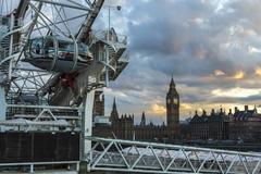 London, UK - 2016.04.05: Big Ben and the London Eye sunset - stock photo
