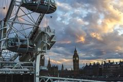 London, UK - 2016.04.05: Big Ben and the London Eye sunset Kuvituskuvat