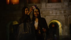 Coliseum at Night. Girls Korean, Japanese, Chinese have fun making photo selfie Stock Footage