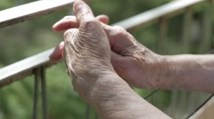 4K Closeup on Old Wrinkled Hands of a Woman Outdoors - stock footage