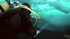 Divers explore the underwater world of the Arctic Ocean at the North Pole. - stock footage