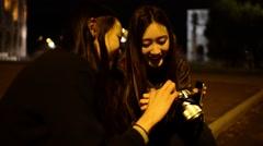 Coliseum at Night. Girls Korean, Japanese, Chinese browse photos at camera Stock Footage