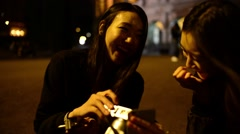 Coliseum at Night. Girls Korean, Japanese, Chinese browse photos at camera Stock Footage