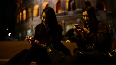 Coliseum at Night. Girls Korean, Japanese, Chinese chating sms Mobile iphone Stock Footage