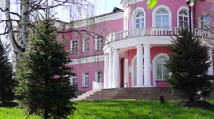 Pink-white public palace tilt down Stock Footage