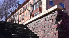 Granite stairs and old house Stock Footage