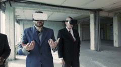 Businessmen in oculus rift using 360 degree interface Stock Footage