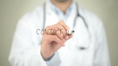 Contact Us, Doctor writing on transparent screen Stock Footage