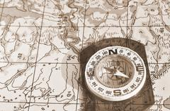 Tools for the journey - map and compass. - stock photo