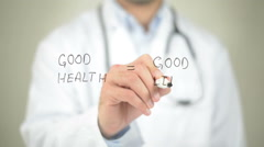 Good Health, Good Life, Doctor writing on transparent screen Stock Footage