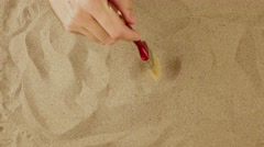Archaeologist discovers vintage compass under desert sand surface Stock Footage