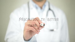 Precaution is Better than Cure, Doctor writing on transparent screen Stock Footage