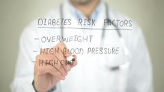 Diabetes Risk Factors, Doctor writing on transparent screen Stock Footage