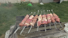 Barbeque skewers with meat cooking on brazier Stock Footage