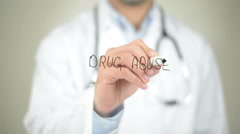 Drug Abuse, Doctor writing on transparent screen Stock Footage