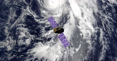 Top view of Earth-observing Calipso spacecraft in orbit above a major hurricane. Stock Footage