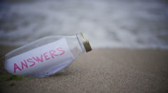 Answers written on a message washed ashore Stock Footage