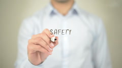 Safety First,  Man writing on transparent screen Stock Footage