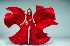 Woman in red fluttering dress Stock Photos