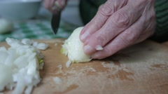 4K Old Woman Hands Chopping An Onion Stock Footage