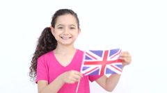 Young british girl with the flag of United Kingdom Stock Footage