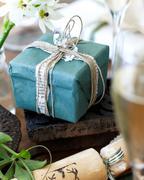 Close up of handmade christmas gift wrapping and christmas cracker - stock photo
