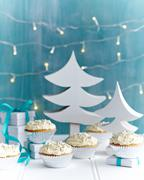 Christmas cupcakes decorated with silver cake decorations in festive setting Kuvituskuvat