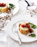 High angle view of goat cheese roulade with tomatoes and basil on elegant plate Stock Photos