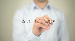 Save the Water,  Man writing on transparent screen Stock Footage