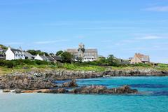 Coast of iona with view of abbey - stock photo
